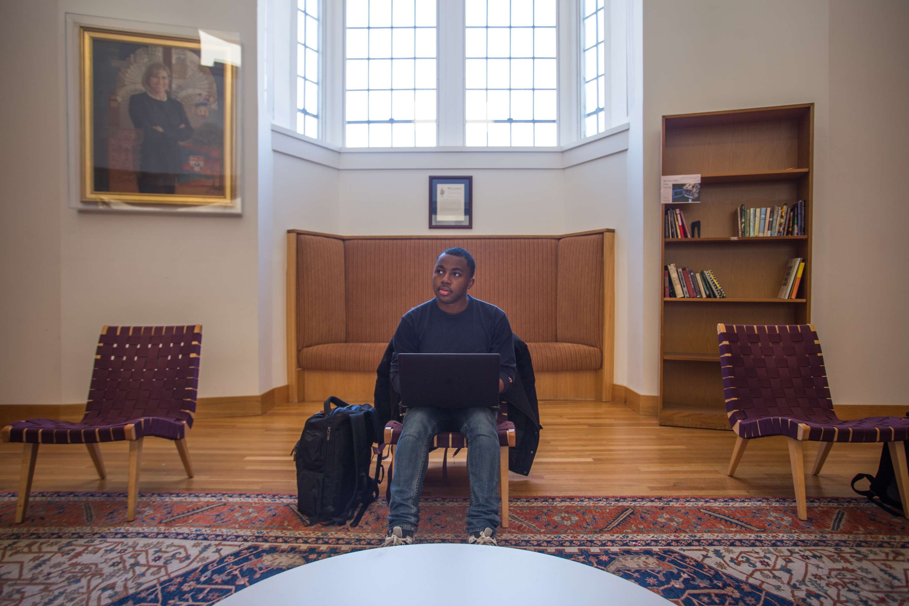 Sonari sitting on a chair in a large room