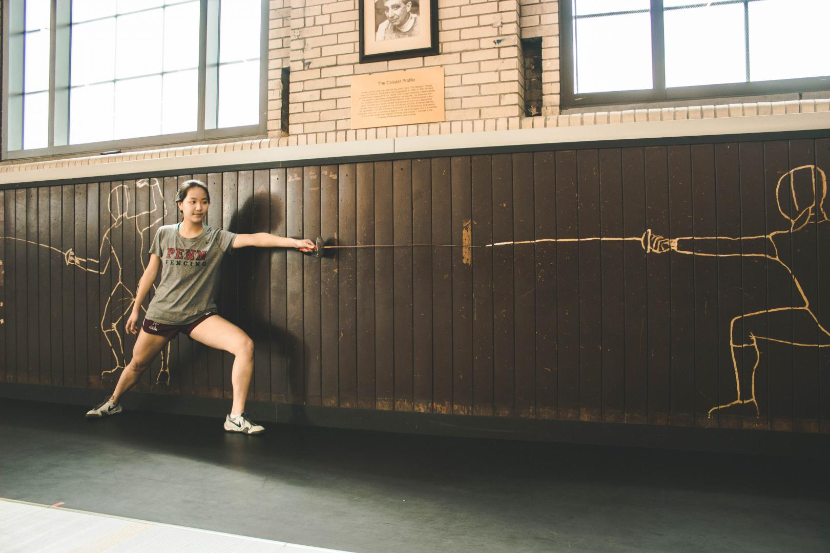 Penn student fencer in a training facility