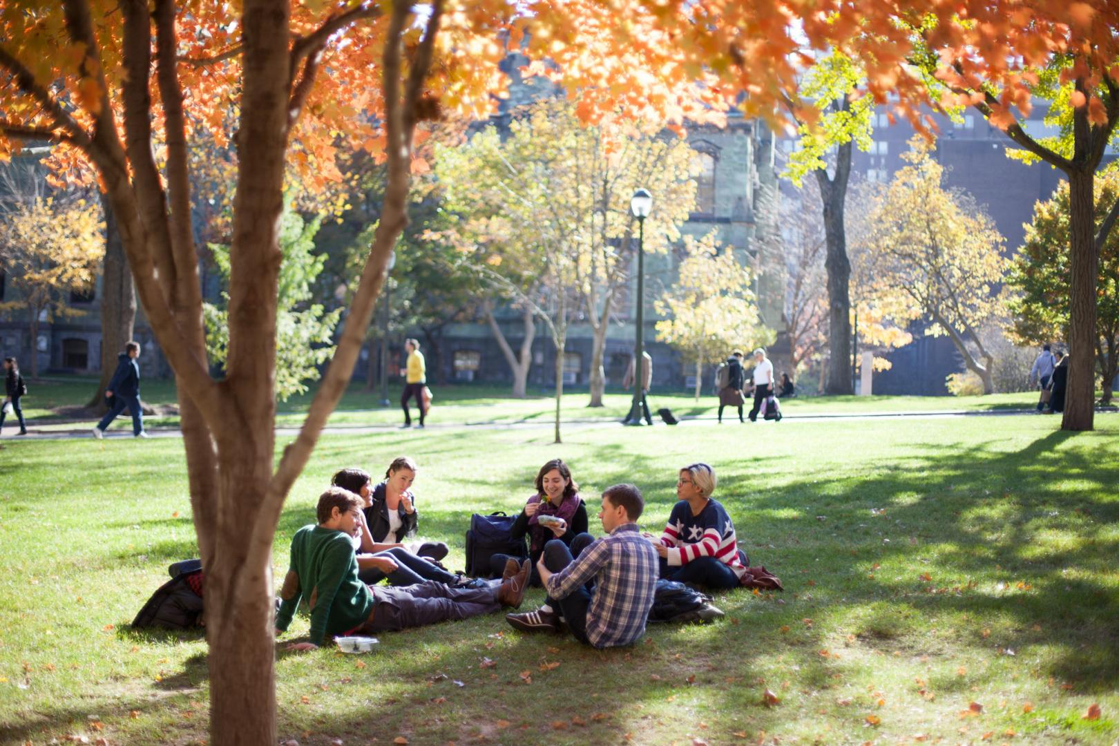 ED RD students sitting on college green in the fall