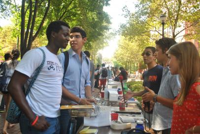Students at activities fair on Locust Walk