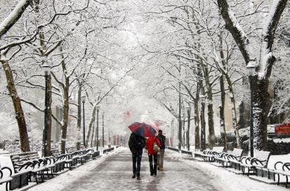 Students walking on Locust Walk in the snow