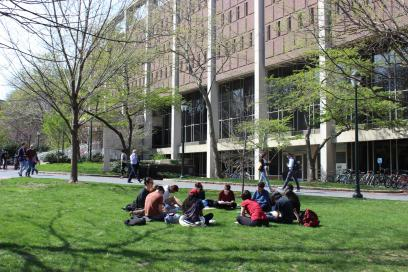 Students sitting on College Green near Van Pelt Library